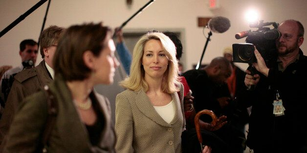 Former CIA employee Valerie Plame Wilson walks through the halls of the Rayburn House Office Building after testifying at a H