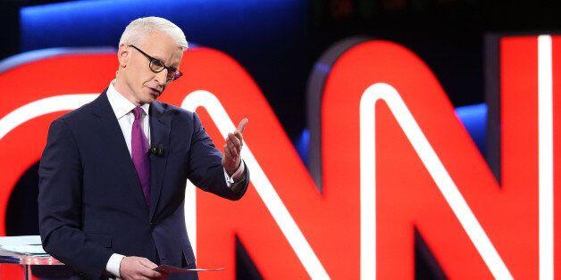 FLINT, MI - MARCH 06:  Debate moderator Anderson Cooper looks during the CNN Democratic Presidential Primary Debate between D