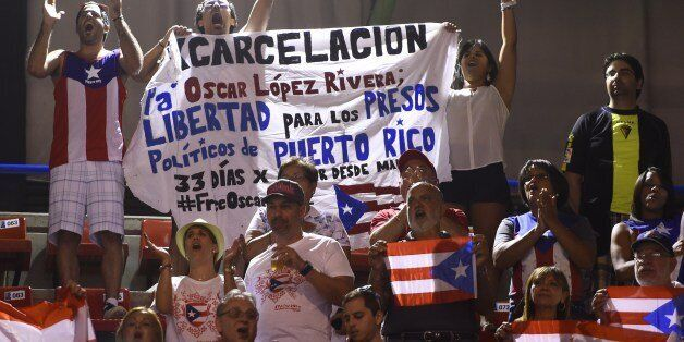 Some Puerto Rico's fans hold a banner demanding the release of Puerto Rican political prisoner Oscar Lopez Rivera during the