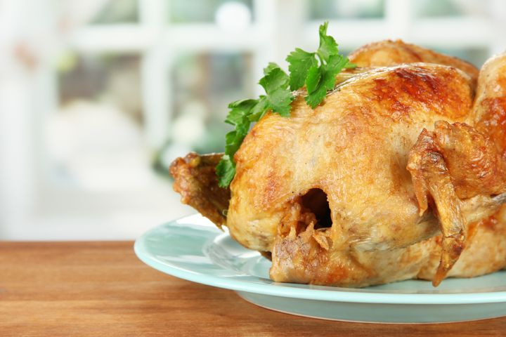 roasted whole chicken on a blue ...