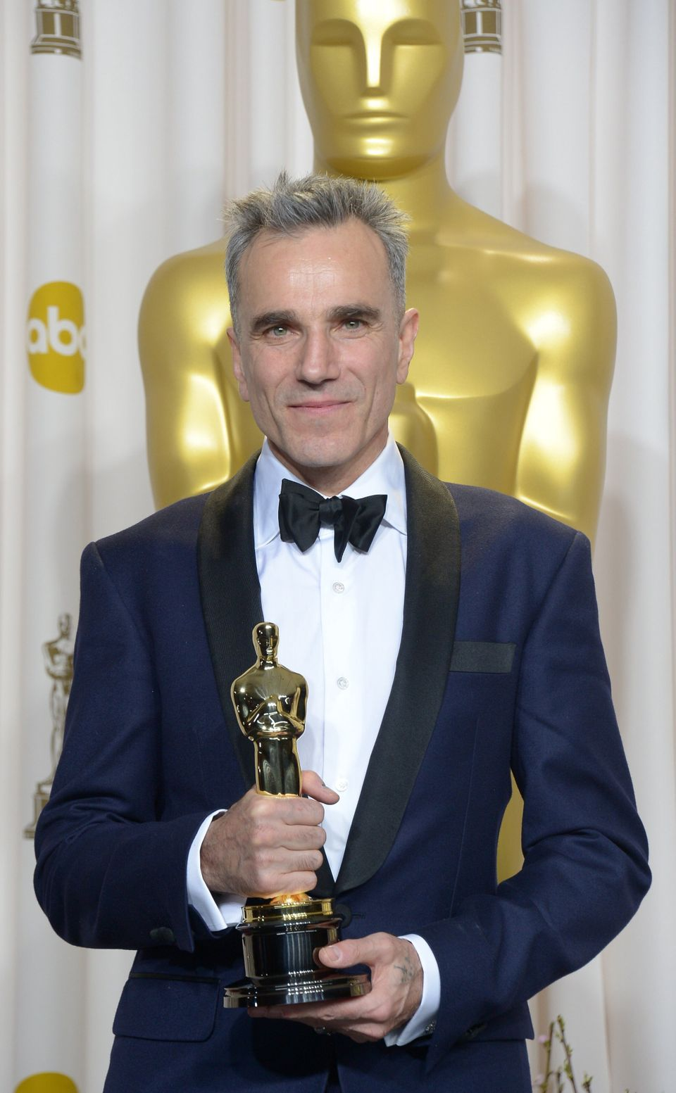 Daniel Day-Lewis holds his Best Actor Award during the 85 Academy Awards on February 24, 2013 in Hollywood, California. AFP P