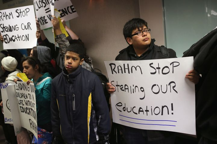 CHICAGO, IL - MARCH 25:  Students protest outside the Chicago Public Schools headquarters against the city's plan to close mo