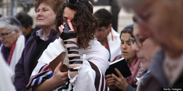 A member of the liberal religious group Women of the Wall wearing phylacteries and a 'Tallit' traditional Jewish prayer shawl