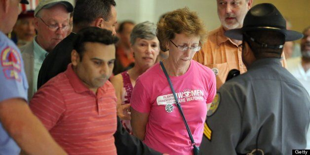 Janet Colm, CEO of Planned Parenthood of Central North Carolina, is arrested for an act of civil obedience at the North Carol