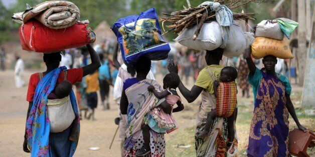 Displaced South Sudanese women walk towards the United Nations Mission in South Sudan (UNMISS) base in Malakal on January 12,