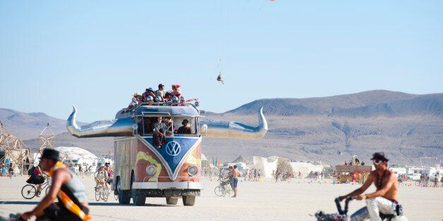 BLACK ROCK CITY, NV - SEPT 2: Like a scene from the World's Fairs of yesteryear, 2011 Burning Man participants intermingle wi