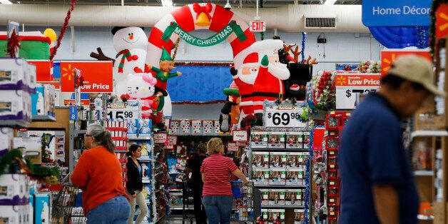 Customers shop at a Wal-Mart Stores Inc. location ahead of Black Friday in Los Angeles, California, U.S., on Tuesday, Nov. 26