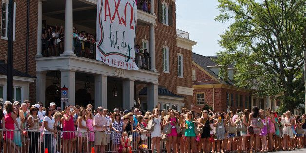 The University of Alabama's Alpha Chi Omega members, family and friends stand outside of the sorority house waiting on the ne
