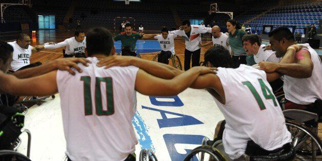 Mexican's basketball wheelchair players  celebrate after winning  the First Central America, Mexico and the Caribbean Basketb