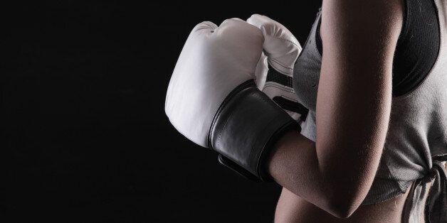 woman boxer on black background