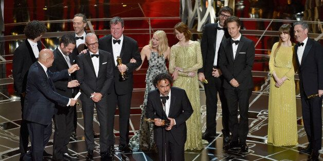 HOLLYWOOD, CA - FEBRUARY 22:  Director Alejandro Gonzalez Inarritu (C) with cast and crew accept the Best Picture award for '