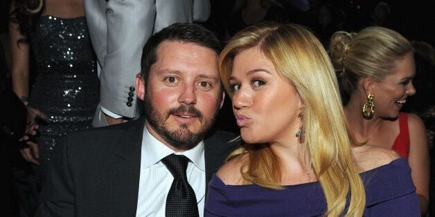 LAS VEGAS, NV - APRIL 07:  Singer Kelly Clarkson (R) and Brandon Blackstock in the audience during the 48th Annual Academy of
