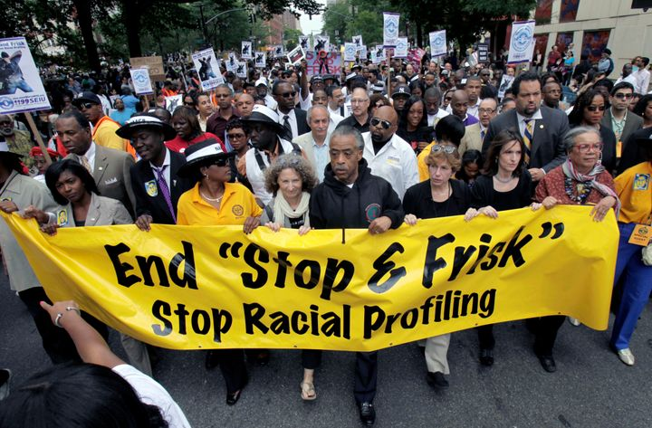 "Rev. Al Sharpton (center) led demonstrators during a silent march calling for an end the of ""stop and frisk"" program that was"