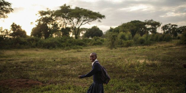 A Tanzanian girl smiles as she makes her way back from school in Arusha, eastern Tanzania, Thursday, Jan. 15, 2015. The city