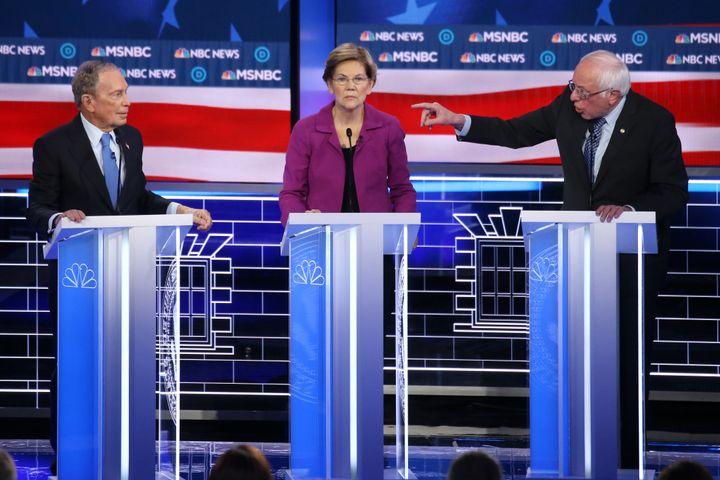 Sen. Bernie Sanders gestures at former New York City Mayor Mike Bloomberg asSen. Elizabeth Warren listens during the De