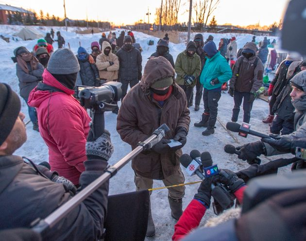 A protester at a rail blockade in St-Lambert, south of Montreal, Que. reads a statement to the media...