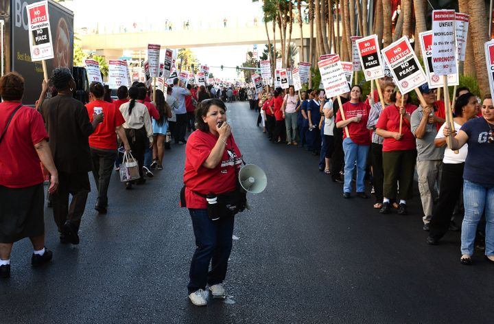 Culinary union members demonstrate outside The Cosmopolitan of Las Vegas in June 2013. The famously militant union is wary of