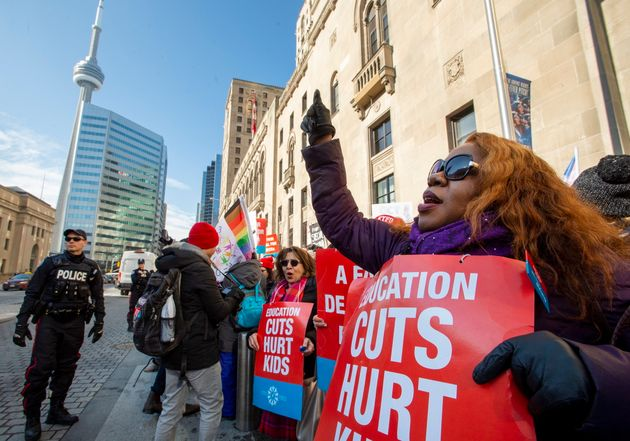 Ontario teachers protest outside in downtown Toronto on Feb. 12 as the province's education minister...