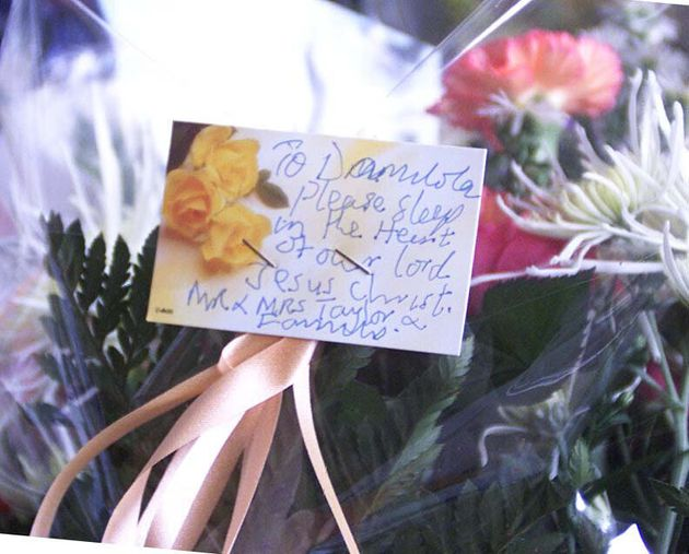 Flowers from the parents, Richard and Gloria Taylor, of murdered 10-year-old Damilola, left while visiting the spot where their son was killed in Peckham. Police hunting the killers of the 10-year-old  arrested two youths and a woman in connection with the murder. Detective Superintendent David Dillnutt told a press conference at New Scotland Yard that the arrests were made at 6am at addresses in Southwark, south east London. See PA News story POLICE Boy. PA photo: Sean Dempsey