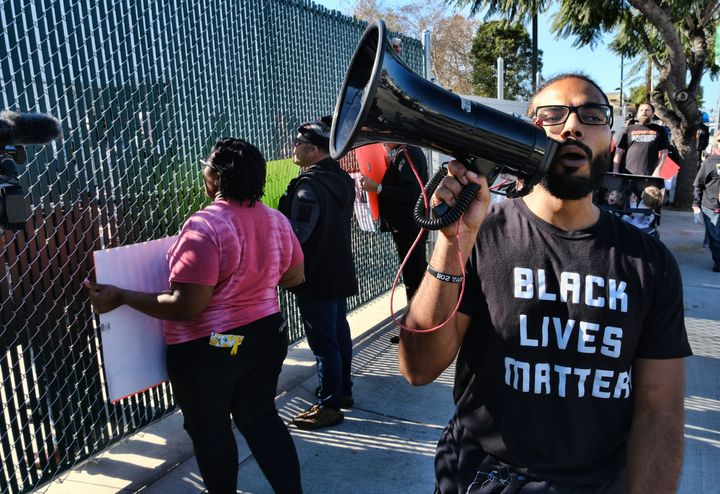 Demonstrators with Black Lives Matter protest a visit by Buttigieg to a homeless shelter in Los Angeles on Jan. 10, 2020.