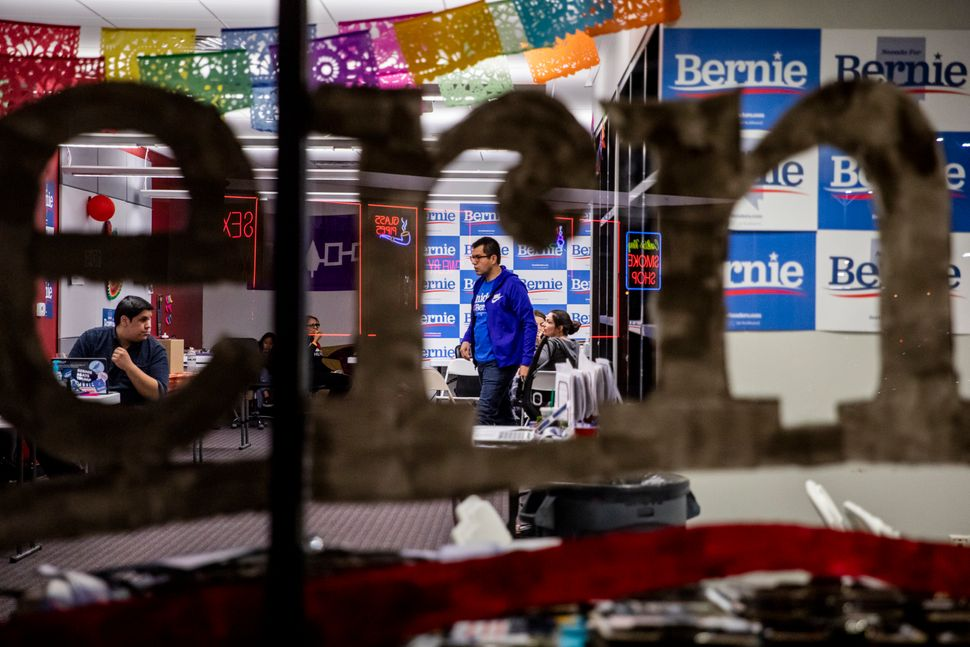 Volunteers for Sen. Bernie Sanders (I-Vt.) work late during the last day of early voting at their East Las Vegas headquarters