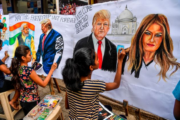 TOPSHOT - Students paint on canvas faces of US President Donald Trump (C), his wife Melania (R), and...