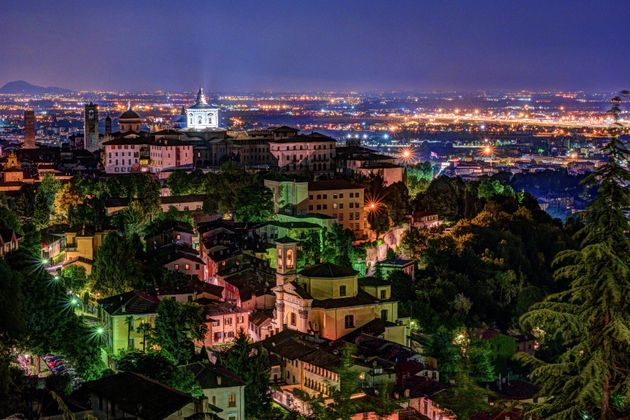View at Old Town Citta Alta of Bergamo from San Vigilio Hill. Bergamo, Italy. Night
