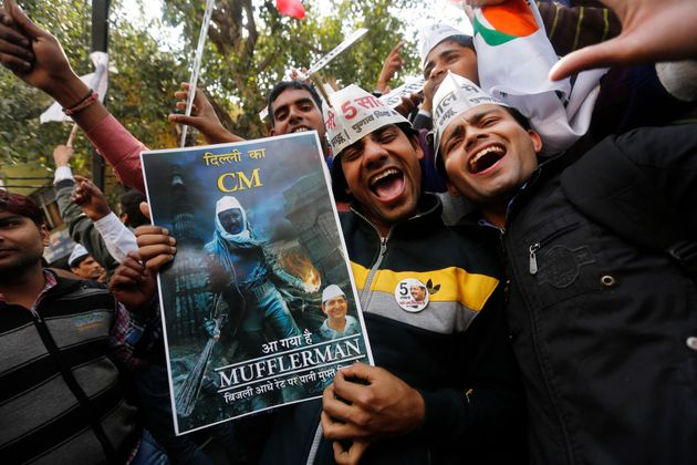 Supporters of Aam Aadmi (Common Man) Party (AAP) take part in the celebrations outside the AAP office...