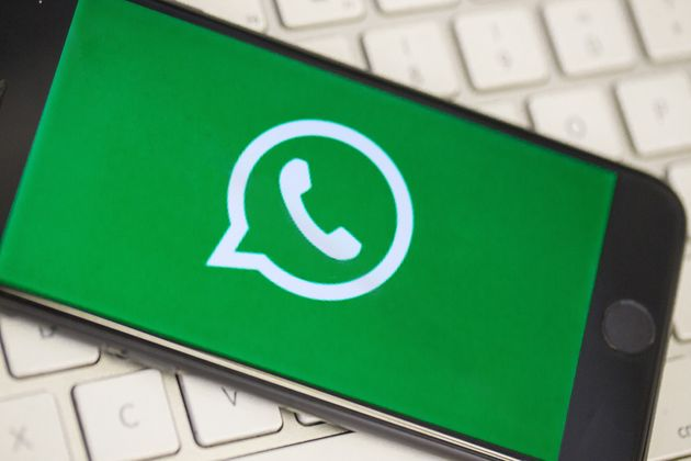 ANKARA, TURKEY - AUGUST 28 : A phone screen over a keyboard displays the logo of WhatsApp applications...
