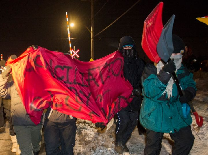 Protesters leave a rail blockade in Saint-Lambert, Que. on Friday.
