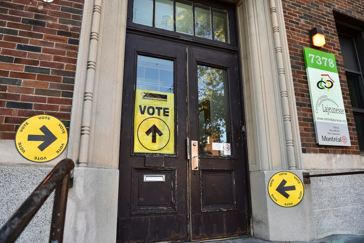Signs direct Canadian voters on election day at a polling station in Montreal on Oct. 21, 2019.