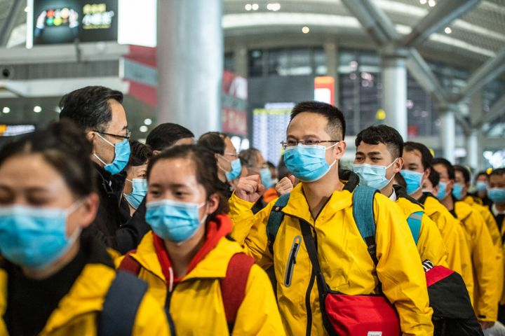 Members of a medical team attend a ceremony before leaving for Hubei Province at the Guiyang Longdongbao International Airport.