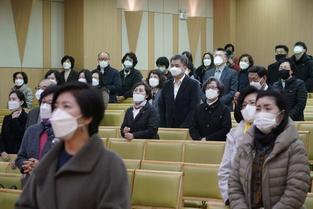 Christian faithful wearing masks to prevent contacting coronavirus pray during a service in Seoul, South...