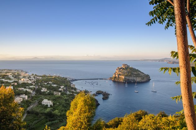 Aerial view on Aragonese castle at sunset, Ischia,