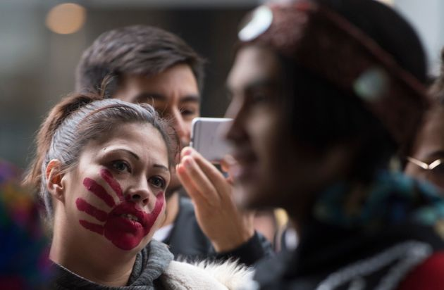 Protesters gather outside the Coastal GasLink offices in downtown Vancouver on Feb. 12,