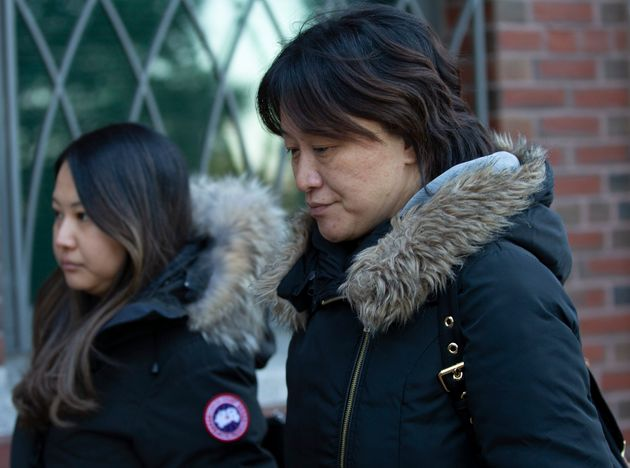 Xiaoning Sui leaving court in Boston on Feb. 21,