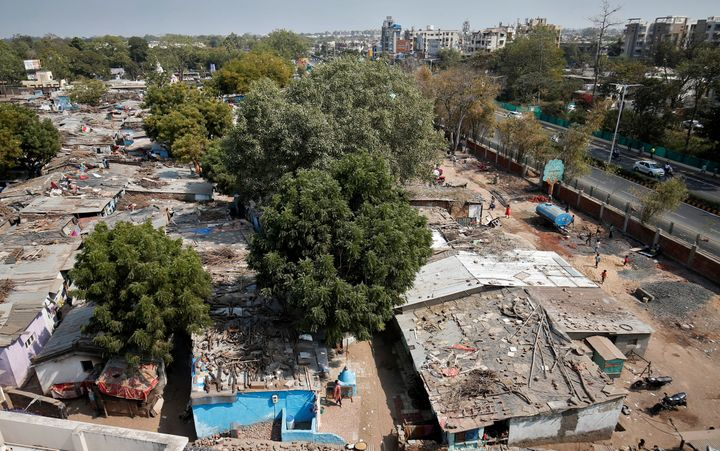 A view of a slum area where a wall was built as part of a beautification drive along a route that U.S. President Donald Trump and India's Prime Minister Narendra Modi will be taking during Trump's visit later.