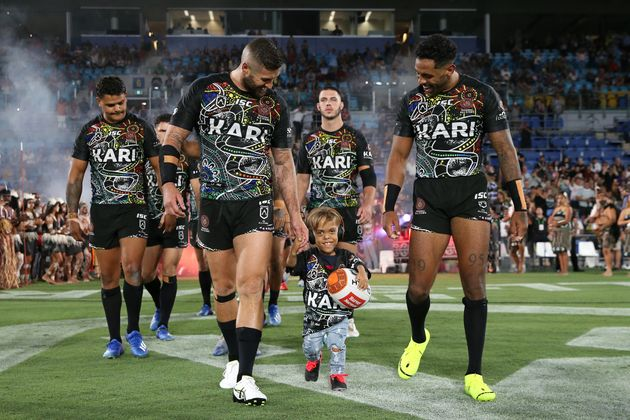 Quaden Bayles runs onto the field before the NRL match between the Indigenous All-Stars and the...