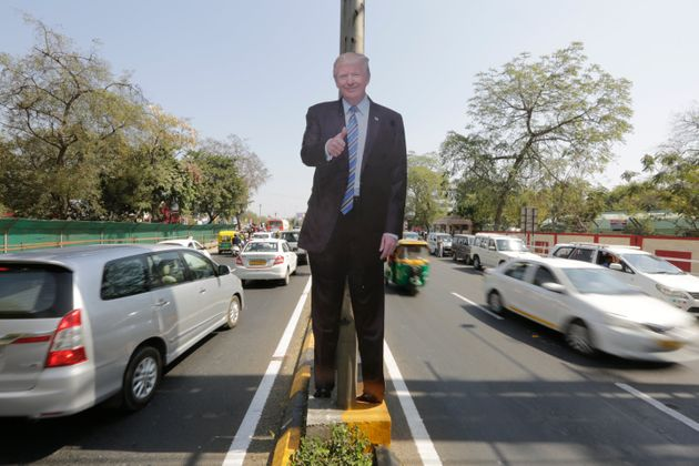 A life size cut-out of U.S. president Donald Trump on a road divider, ahead of his visit in Ahmedabad,...