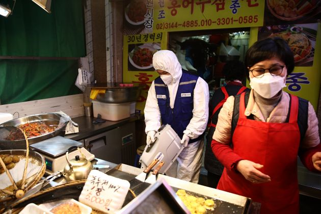 SEOUL, SOUTH KOREA - FEBRUARY 24: A disinfection professional  wears protective gear spray anti-septic solution against the coronavirus (COVID-19) at a traditional market on February 24, 2020 in Seoul, South Korea.