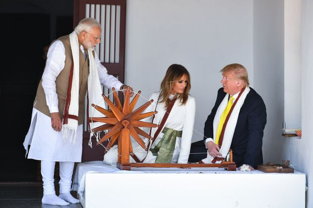 US President Donald Trump and First Lady Melania Trump listen to Prime Minister Narendra Modi (L) as...