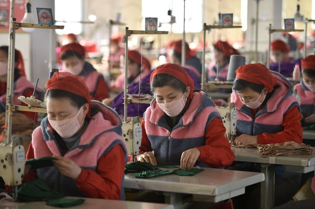 In this photo taken on February 6, 2020, workers of Songyo Knitwear Factory in Pyongyang produce masks...