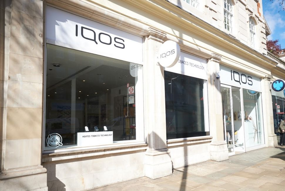 Iqos shops are sleek, with big museum-table