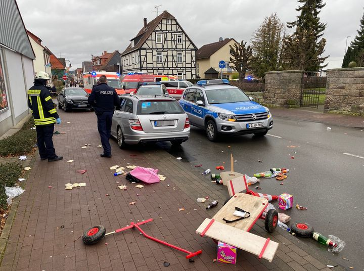 A broken handcart is seen in front of cars of the police, the fire brigades and an ambulance on Rose Monday, February 24, 202