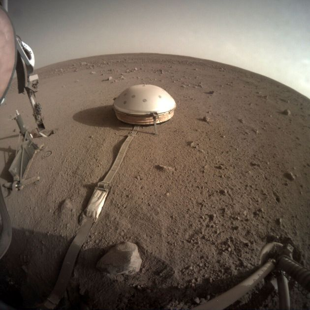 This Feb. 18, 2020 photo made available by NASA shows the InSight lander's dome-covered seismometer,...