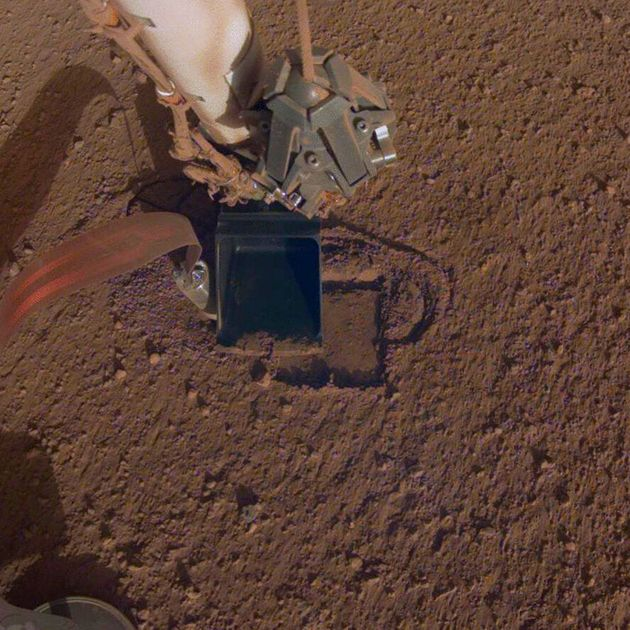 This October 2019 photo made available by NASA shows InSight's heat probe digging into the surface of...