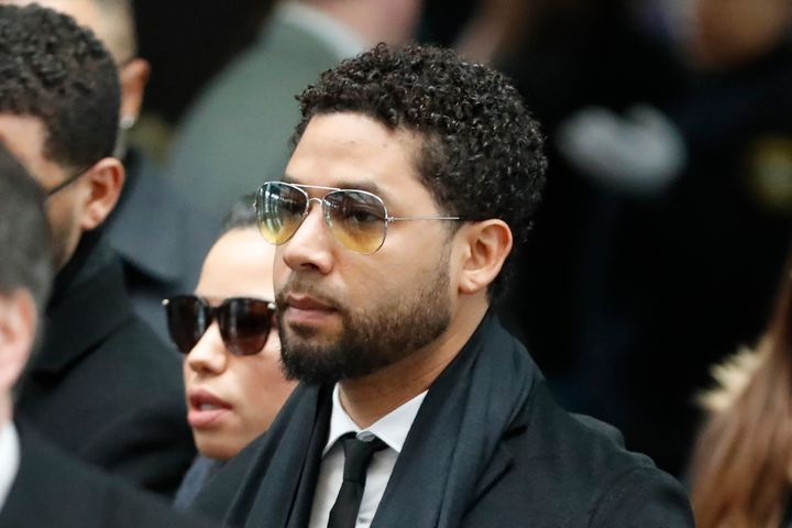 "Former ""Empire"" actor Jussie Smollett, center, arrives for an initial court appearance Monday, Feb. 24, 2020, at the Leighton"