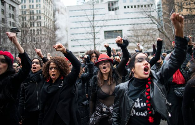 Women protest against rape while Harvey Weinstein attends a pretrial session on Jan. 10, 2020 in New...