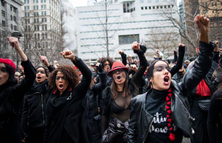 Women protest against rape while Harvey Weinstein attends a pretrial session on Jan. 10, 2020 in New York City.