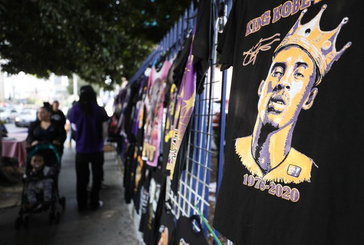 """Memorabilia is sold outside the """"Celebration of Life for Kobe and Gianna Bryant"""" on Monday at Staples Center in Los Angeles."""